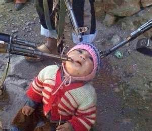 Baby about to be murdered by ISIS soldiers.